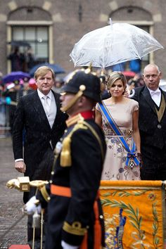 Dutch King Willem-Alexander and Queen Maxima arrive to rainfall on the special day