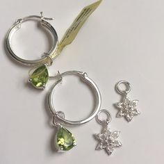 ❄️Peridot & Diamond hoop earrings❄️ Snowflakes!!  Genuine Peridot, pear shape and Diamond hoop earrings. Switch up your look with a set of snowflakes! Both charms included. Sterling silver, nickel free. Total diamond weight (TDiaWt) 0.010cts, Total gem weight (TGW) 2.01cts Jewelry Earrings