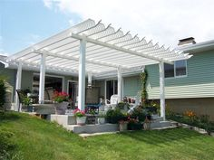 This pergola by Vinyl By Design is simply perfect in every way!