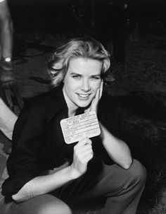 """theacademy:  Grace Kelly makeup reference shot from Green Fire (1954). The card she holds reads """"hair mussed,"""" and is dated May 3, 1954."""