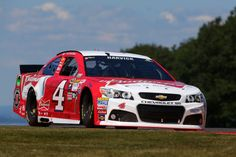 Kevin Harvick, driver of the #4 Budweiser/Jimmy John's Chevrolet, races during the NASCAR Sprint Cup Series Cheez-It 355 at the Glen at Watkins Glen International on August 9, 2015 in Watkins Glen, New York.