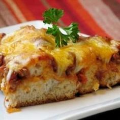 An easy pizza made with a biscuit crust, ground beef, pepperoni, pizza sauce, and your favorite pizza toppings. A favorite with kids.