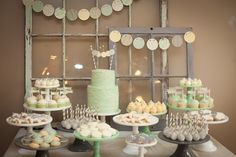 We love the old window frames as backdrop for the dessert table.