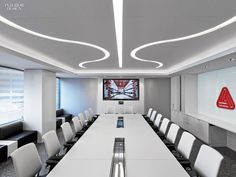 Channels in the boardroom's stretched ceiling allow LEDs to shine through. Photography by Eric Laignel. Interior Design Magazine, Office Interior Design, Corporate Interiors, Office Interiors, Cool Office, Office Decor, Office Furniture, Workplace Design, Corporate Design