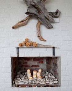 Not crazy about the driftwood, but really love the seashells and candles and dried flowers