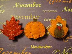 Celebrate Fall in style with one of these handmade pins. These are all made from hand-drawn patterns are are handcut and sewn. All three are two layers or more of felt with a 1 inch pinback securely fastened on the back. Choose your favorite! The red leaf has yellow and orange detailed stitching and measures 1 3/4 inches tall.    The turkey is orange, brown and red with google eyes and measures 1 1/2 inches tall.    The pumpkin is orange with brown detailed stitching and measures 1 1/2…