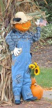 patriotic Jack the scarecrow waving a flag