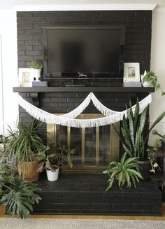 Spring Boho Modern Mantle- simple black and white mantle with greens