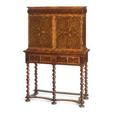 A FINE WILLIAM AND MARY OLIVE WOOD VENEERED CABINET ON STAND circa 1690 the…