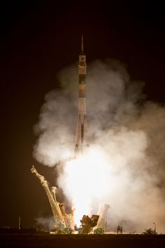 Soyuz Rocket Launches Space Station Crew on Express Trip: A Soyuz rocket with Expedition 36/37 Soyuz Commander Fyodor Yurchikhin of the Russian Federal Space Agency (Roscosmos), Flight Engineers: Luca Parmitano of the European Space Agency, center, and Karen Nyberg of NASA, onboard, launches from the Baikonur Cosmodrome in Kazakhstan to the International Space Station, Wednesday, May 29, 2013.