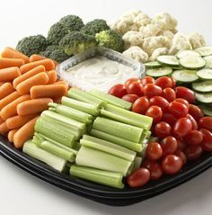 Every party needs a vegetable tray! This one's got celery, cherry tomatoes, baby carrots, cucumber slices and broccoli and cauliflower florets with our creamy ranch for dipping. Perfect!