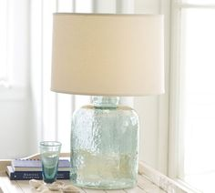 Love this jar lamp base with old looking glass.