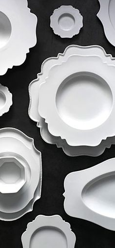 Reichenbach fine dinnerware by Paola Navone. The beautiful curving lines and wide borders give a unique silhouette to each piece.