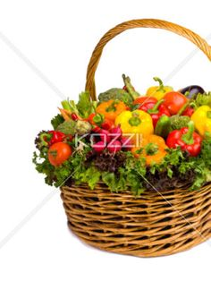 basket of vegetables - A big basket of vegetables on a white background, coming from the right side.