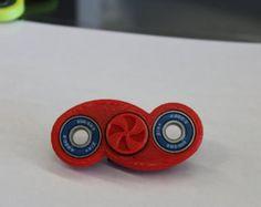 Rotobow fidget spinner por FidgetGear en Etsy