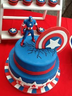 I baked this cake for my son's 7th birthday.  This #CaptainAmericaCake is made of chocomoist cake with dark chocolate filling covered with fondant. The shield is made of gumpaste that I put through the cake and made some lines to create the crack effect.  The cupcakes are made of chocomoist cupcakes as well and the toppers are fondant. #CaptainAmericaThemedCake #CaptainAmericaCupcakes #IrenesHomebakedGoodies