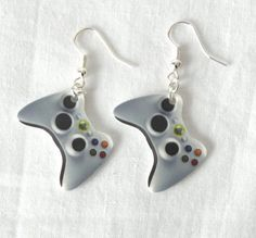 """Brandon saw these and said """"YOU MUST BUY THOSE FOR YOURSELF!"""" and I said """"but I don't even know how to use an Xbox controller!"""" to which he replied """"That's not true, you know how to spin in circles.. and look up.""""  Hahaha :)  I guess I need practice. These earrings are very cute!"""