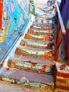 Beautifully Painted Stairs From All Over The World----Valparaiso, Chile. This staircase is another beautiful display of art in Valparaiso, Chile. The detail of the houses and the ocean views is absolutely stunning. Beautiful Stairs, Beautiful Streets, Angers France, Escalier Art, Stairway Art, Performance Artistique, Art Du Monde, Urbane Kunst, Best Street Art