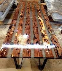 Resultado de imagen para River bend table Cherry wood, hemlock, river stones, epoxy
