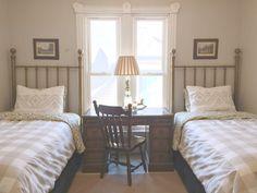 twin beds, guest bedroom, antique brass headboard, sisal rug, english hunting art, buffalo check,