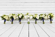 white and green bouquets // photo by Thompson Photography Group