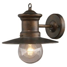 Cast a warm glow on your patio or garden with this lovely outdoor wall lantern, showcasing a hazelnut bronze finish and clear seeded glass shade.