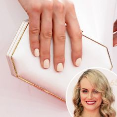 Taylor Schilling: Orange Is the New Black star Taylor Schilling went with a warm ivory polish to match her cream and gold look from the Emmys.