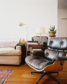 Living Room Modern Photo   A Black Eames Chair Paired With A Beige Couch  And A