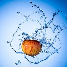 "Apple Splash | by Graham Scarborough via Flickr - ""One light behind translum for the background spot. 60° Gridded light camera left for lighting the apple and splashes. Reflector camera right to fill the shadow."""