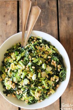 Simple Shredded Kale + Brussels Salad drizzled with a creamy champagne vinaigrette! #vegan