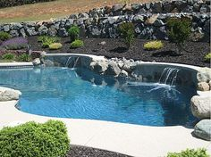 Rock wall behind the pool for the front yard....