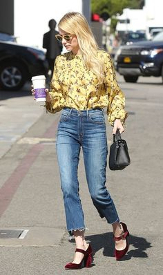Printed blouse tucked into high waist jeans.