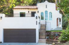 Spanish Revival (take a peek at this renovation... it's mind-blowing!)