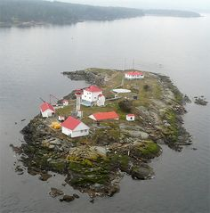 Entrance Island lighthouse located just outside Nanaimo Harbour on Vancouver Island, BC Canada. This lighthouse station also provides weather info to mariners on the VHF weather channel