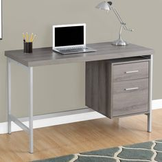 Sleek and contemporary, this finished desk is the perfect combination of function, durability and design in a modern form. With clean lines, a large, thick paneled surface and stylish silver metal legs, this piece will add pizzazz to any home office. Featuring a large storage drawer and a file drawer accented by silver colored drawer pulls to help keep your office supplies and documents organized and desktop clutter free. This desk provides plenty of room to meet your working needs without…