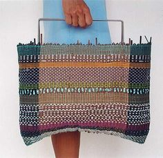 Hand woven bag from Joanna Louca. The handle looks a little uncomfortable but who cares with that gorgeous bag?