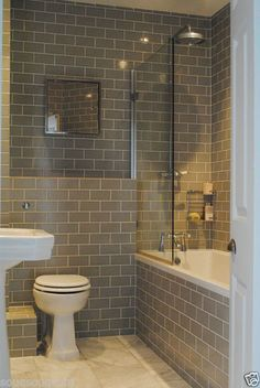 Clean and simple lines for this no nonsense family bathroom - brick laid tiles. Katharine & James' Glamorous Family Home in London : Apartment Therapy Family Bathroom, Master Bathroom, Bathroom Grey, Metro Tiles Bathroom, Best Bathroom Tiles, Master Baths, Classic Bathroom, Kitchen Tiles, Apartment Therapy
