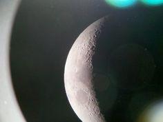 Photo of the moon through a telescope.