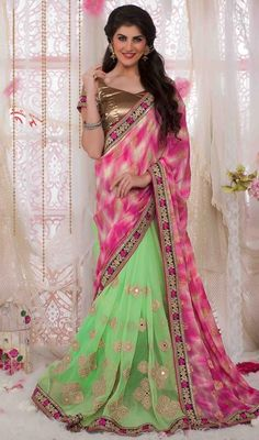 Plunge into elegance wearing this honeydew and pink color georgette half n half sari. This attire is beautifully adorned with lace, mirror, patch and resham work. Upon request we can make round front/back neck and short 6 inches sleeves regular saree blouse also. #AwesomeReshamButtaWorkSari