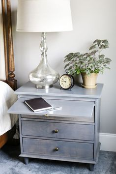 Free DIY Nightstand Plans - Learn how to build a DIY nightstand with built-in charging station and pull out writing tray. Tutorial by @thejenwoodhouse. http://spr.ly/6498BNs6G