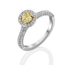 Boodles Vintage Classic yellow diamond engagement ring in platinum, set with a round-brilliant cut yellow diamond