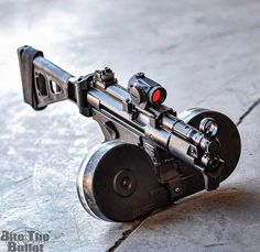 Double drum magazine on an MP5K --- under the present circumstances it could be really handy....
