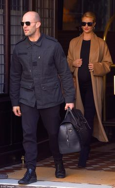 Checking out: Jason Statham and expectant fiancee Rosie Huntington-Whiteley left their Manhattan hotel Sunday after attending Saturday's premiere The Fate of the Furious
