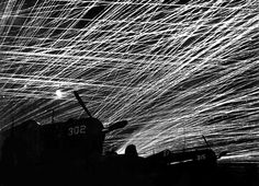 """Japanese night raiders are greeted with a lacework of anti-aircraft fire by the Marine defenders of Yontan airfield, on Okinawa. In the foreground are Marine Corsair fighter planes of the """"Hell's Belles' squadron. Exact Date Shot Unknown (Marine Corps) Bristol Beaufighter, Nagasaki, Hiroshima, Pearl Harbor, Iwo Jima, Ww2 Photos, Ww2 Pictures, Air Raid, Military History"""