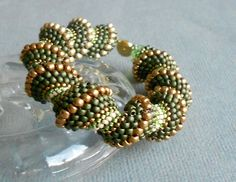 ON SALE olive spiral beaded bracelet by beadnurse on Etsy