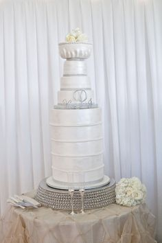 Stanley Cup wedding cake. I lost a bet with my husband but it came out beautifully! Cake design by Molly B's.