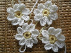 Tutorial for lovely crocheted daisies - I like these ones - and I'm very pleased with the one I've made :-)