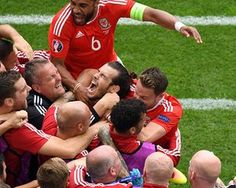 Gareth Bale of Wales is mobbed after the opening goal in the Euro 2016 game with Slovakia