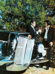 #elvis being presented the keys to a new Stutz, his favorite car.