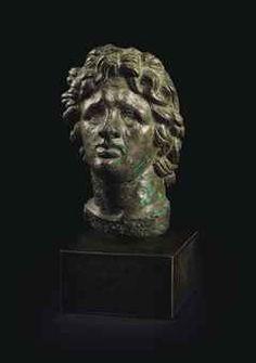 A ROMAN BRONZE HEAD OF ALEXANDER THE GREAT  CIRCA 2ND CENTURY A.D.